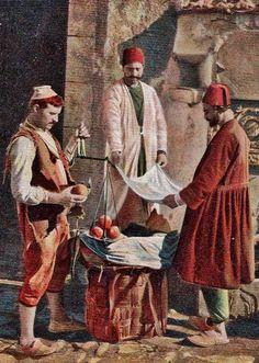 STREET SELLER. 'Meyve satıcısı' (fruit seller). Istanbul, ca. 1900. (Coloured photograph).
