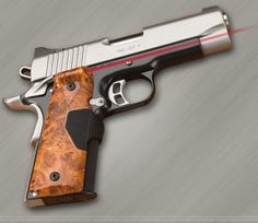 1911 Sig Sauer With Crimson Trace Sights.   This is on my wish list.