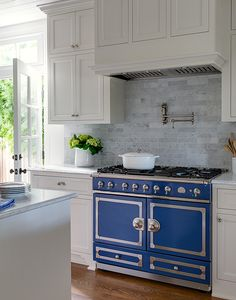 Kitchen Before and After with blue range: Los Angeles project