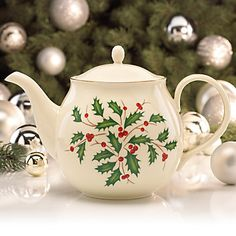 This delightful holiday teapot is made of fine porcelain and crafted by famous maker, Lenox.Classic Red and Green Holly motif Accented with 24 karat gold Height: Capacity: 48 ounces Christmas Tea Party, Christmas China, Christmas Dishes, Lenox Christmas, Christmas Kitchen, Green Christmas, Santa Christmas, Christmas Holidays, Christmas Dinnerware