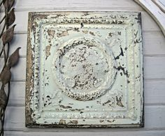 MEASUREMENTS:  23 1/2 x 23 1/2 (framed) COLOR:  Old original paints of a pale, pale aqua tone, beige and bronze color and chips of weathered off