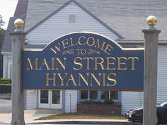 Welcome to Main Street, Hyannis! Seaport Village Realty is behind this sign! That's us!