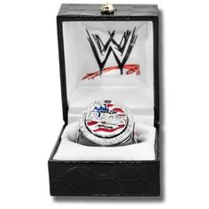 WWE John Cena US Word Life Championship Replica Finger Ring by WWE. $60.00. Introducing the Officially Licensed WWE John Cena US Wordlife Championship Replica Finger Ring. Made by Figures Toy Company. The center plate really spins. The ring is made of brass to simulate the gold and also is finished with black hematite to simulate the belt strap. The ring has an adjustable shank that fits rings size 6 to 12 with ease. Ring is shipped in a black jewelry box with the WWE logo pri...