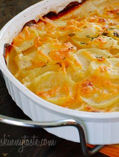 Thinly sliced yukon gold potatoes, layered and baked in a light buttery sauce with cheese – so good with less guilt!