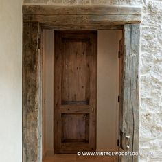 Not every #reclaimedwood beam ends up a beam in a new project. This doorway is finished with antique hand hewn beams giving it a truly unique and old world look. | vintagewoodfloors.com