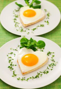 fried eggs on toasted bread. Cut with heart-shaped cutter.