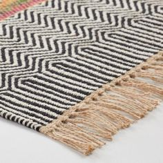 An eclectic update to the traditional chindi rug, our exclusive rug is handwoven by Indian artisans of reclaimed fabrics with black and gray geo-printed African Interior Design, Rug Over Carpet, Rug World, Jute Rug, Bedroom Carpet, World Market, Rugs In Living Room, Living Area, Furniture Inspiration