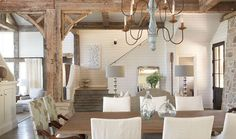 rustic dining room, grey/driftwood style flooring, and stone fireplace, all just too beautiful.