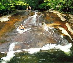 Sliding Rock is a 60' natural rock slide with a 6-7 foot deep pool at the base - perfect for you folks looking for a waterfall to slide down.