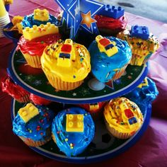 Lego cupcakes with chocolate lego's and chocolate lego men. I ordered the mold off of Amazon. Poured yellow melting chocolate in the lego man molds and waited for them to harden. I painted the shirt and pants with colored melting chocolate. Super cute and easy