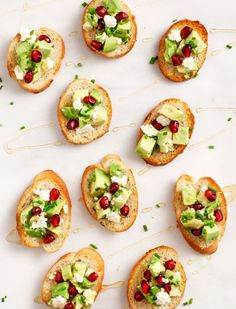 Avocado, pomegranate and feta make a pretty holiday appetizer crostini.