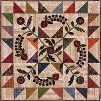 Kim Diehl - Homestead Harvest. I would design my own appliques, but I like the pieced framework for it.