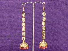 Simulated coral embedded faux pearl kundan long by Indiatrend, $38.99