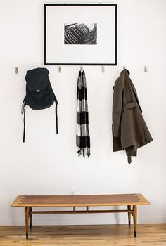 Inside the front door, coats hang from aluminum Bjärnum hooks by Ikea above a vintage Lane coffee table, which Magill bought from a coworker, and beneath a photograph by Beth Mercer. Photo 1 of 1 in IKEA BJÄRNUM Folding Hook Ikea Hooks, Entryway Hooks, Modern Entryway, Entryway Ideas, Light Hardwood Floors, Decoration Inspiration, Interior Inspiration, Design Your Kitchen, Minimal Home