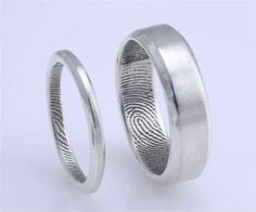 love these, wedding rings with spouses finger prints on inside    http://www.etsy.com/listing/91845450/custom-bevelled-fingerprint-ring-in?ref=v1_other_1
