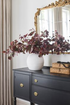 Create a stunning display of fall leaves with these artificial burgundy continus fall leaves. Simply trim their stems down to fit your favorite ceramic vase and enjoy fall without the fuss. Shop this look by @jennasuedesign at Afloral.com.