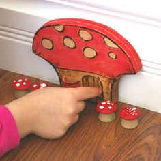 A fairy door...what a delightful way to imagine. A small door-anywhere- in a tree, on a shelf, along the baseboards.