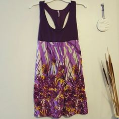 Rue 21 Floral spring/summer dress This is an adorable purple sundress with floral details and crossed back. I am a little over 5'7 and the length is shown in the picture. I love love love this dress, it is just time to phase it out of my wardrobe. Enjoy! Rue 21 Dresses Mini