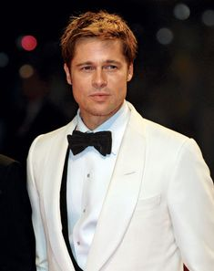 "Okay, people, I'm not obsessed with Brad Pitt, but I have a friend who does not know who he is (?!?!) and I told her that I would get some good pictures together so that I could ""introduce"" them. - Elise"