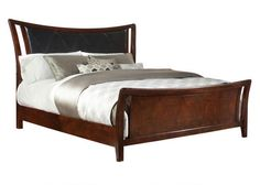 Uptown Style. Upscale flair and a contemporary trim accent this cherry wood collection. The King bed features an upholstered headboard in black Soft Touch PU fabric with argyle patterned top stitching adding a fresh presence to your bedroom. Constructed of sustainable rubberwood solids this magnificent bed has beveled top edges, and bowed case fronts. Graceful, elegant styling you will love for years to come.