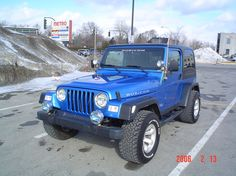 """blue jeep wrangler rubicon 2 door  