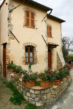 Tuscan Cottage ~ Maybe adding some rustic stones to corner edges would make the exterior stucco not so bland
