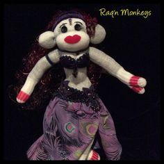 Custom Raq'n Monkey in a peacock theme'd costume