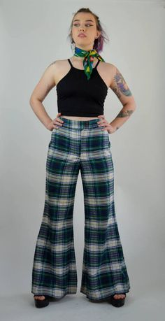Awesome 1970s high waisted mega flares! Done in a lightweight puckered cotton material. High rise fit with doubly button and zipper closure. Fitted legs with mega flared bell bottoms! Unlined.  SIZE: Small / Medium TAG: -- BRAND: --  Excellent Vintage Condition: ♥  Measurements: Waist: 28 Hips: 37 Rise: 13.25 Inseam : 32  Tailers Measurements; bust: 34.5 Waist: 27 Hips: 37.5 Height: 5 6  7M17BLUE  *Any overpayment exceeding $4 USD will be refunded back to your account.  *All items are me...