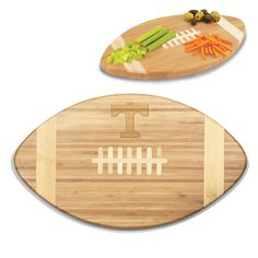 """Short Description: The Touchdown! cutting board is a 15"""" x 8.75"""" x 0.75"""" board made of eco-friendly bamboo with a standard football design, with 123 square inches of cutting surface. It can be used as"""