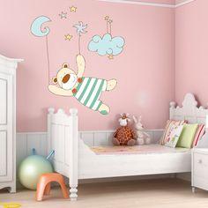 Vinilo decorativo muy tierno para habitacion infantil. Osito colgando de estrellas y de la luna. Osito soñador.