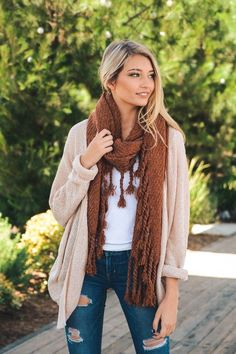 This gorgeous Chunky Oversized Tassel Blanket Scarf is the perfect accessory for Fall & Winter. It features a heavyweight thick fabric with tassels at the ends that will go perfectly with any outfit.