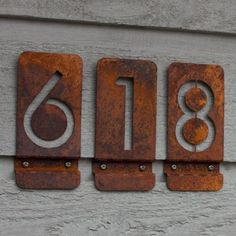 I absolutely love these house numbers...but I'm not sure how we would get them attached to the brick?