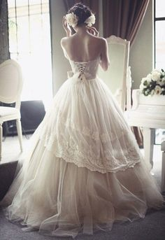 The way the back of this dress laces up all sexy. | 50 Gorgeous Wedding Dresses
