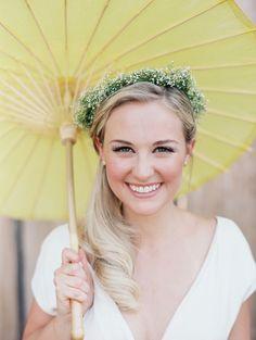 bride with parasol and baby's breath crown // photo by Tara Francis // http://ruffledblog.com/handcrafted-oregon-wedding
