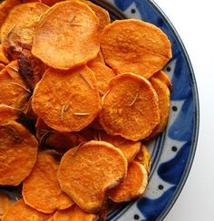 Easy Homemade Sweet Potato Chips- I made these and I will never buy store-bought sweet potato chips ever again! Just pop them in the oven, l...