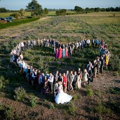 Cute wedding idea, arrange your guests in a heart. And my idea would to put the bride an groom in the center.