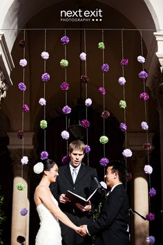 flower back-drop for ceremony adds splashes of colour