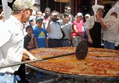 Texas caterers set world record for largest pizza   The Dirt Road Cookers,a team of eight caterers from San Antonio,Texas,broke the Guinness World Record for the largest pizza.The 46.64 square foot pie weighed about 100 pounds and took nearly two hours to cook.Monday,August 19,2013,11:24 AM~A team has created a SLICE of history after landing a spot in the record books for cooking the world's largest pizza.