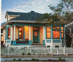 A tricolor treatment of turquoise, chocolate, and white turns the original ornate front door—and the unusual stained glass in its transom—into a focal point while adding dimension to the windows, porch-column bases, and other architectural elements. Porch Columns, Porch Roof, Porch Windows, Front Porch, Clapboard Siding, Bungalow Homes, Types Of Houses, Architectural Elements, Of Wallpaper
