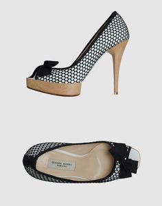 Wooden heel and platform with a hint of fishnet stockings. Open toe pumps by Gianni Marra.