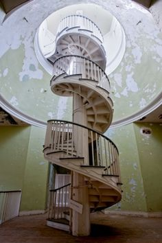 Neat spiral staircase inside the main building of the abandoned Western State Hospital in Virginia, founded in 1825. by coady