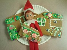 Elf on the shelf... eating the kids' gingerbread house.