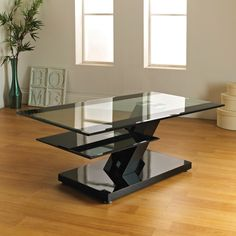 Eden. 10mm tempered glass top table with High gloss MDF base and 7mm glass shelf. Only available in black.  Item Dimensions: H: 43 cm L: 110 cm W: 60 cm  SKU : EDENCTBLK