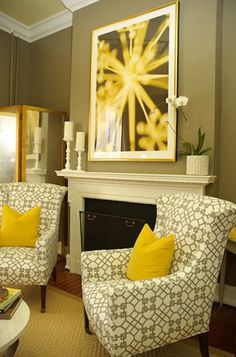 The chairs, the yellow pillows, and the over the fireplace art - it all works for me. May do something like this at home.