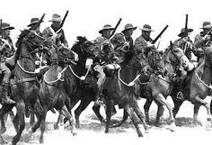 An Australian Light Horse regiment passes through Jerusalem mounted on horseback. Lest We Forget, Photo Lighting, World War I, Wwi, Camel, Army, Military, War Horses, In This Moment