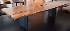 Live edge tables are fabulous against a dramatic & sophisticated backdrop. This table by Louis Fry is stunning.