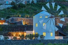 the green windmill // santorini, greece - Get $25 credit with Airbnb if you sign up with this link http://www.airbnb.com/c/groberts22