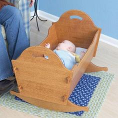 """Gently lull a newborn into sweet slumber with this beautiful, knockdown cradle. For traveling or storage, protect the cradle in its simple-to-make companion box.Overall dimensions: Cradle: 31"""" long, 24"""" wide, 22"""" highStorage Box: 32"""" long, 18"""" wide, 5"""" highFeatured in WOOD Issue 178, September 2007"""