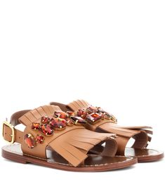Marni - Embellished leather sandals - Marni's leather sandals come in a warm-brown hue and are embellished with glistening red crystals. The flat pair have a chunky supportive ankle strap that fastens with a golden buckle for a luxe finish. Team yours with high hemlines to showcase the bohemian fringing. seen @ www.mytheresa.com