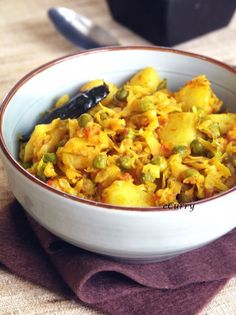 Cabbage with Peas and Potatoes - simple dish of cabbage , peas and potatoes cooked in a Bengaly way (Indian)